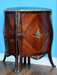 Corner cabinet  Louis XV style France, second half of the 19th century Height: 92 cm